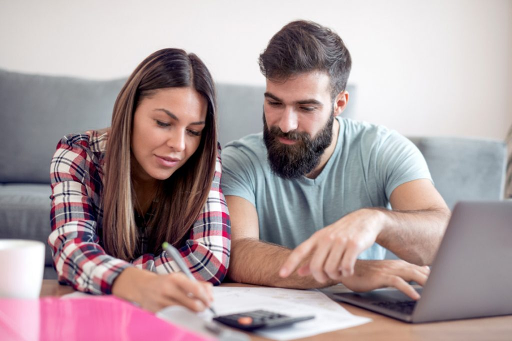 Young couple reviewing their employer-sponsored retirement plan together.