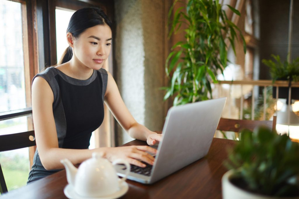 woman on a laptop learning about financial wellness